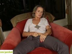 Naked aunt furiously masturbating in the chair.