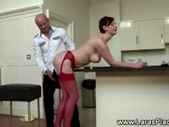 Bald pepper fondles busty neighbor in red stockings.