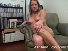 In a chair with lascivious eyes naked Dutch bitch spread legs and slipped a finger in the pussy.