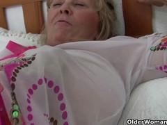 Old woman with big tits up to the navel masturbating on the couch.