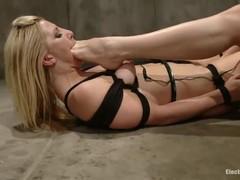 Blond torments associated girlfriend on the floor.