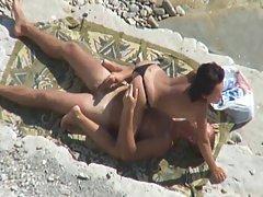 Hot couple enjoys sex on the beach. Voyeur.