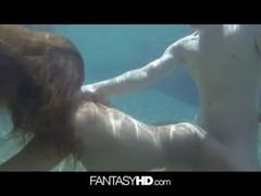 Underwater sex with a hot brunette.